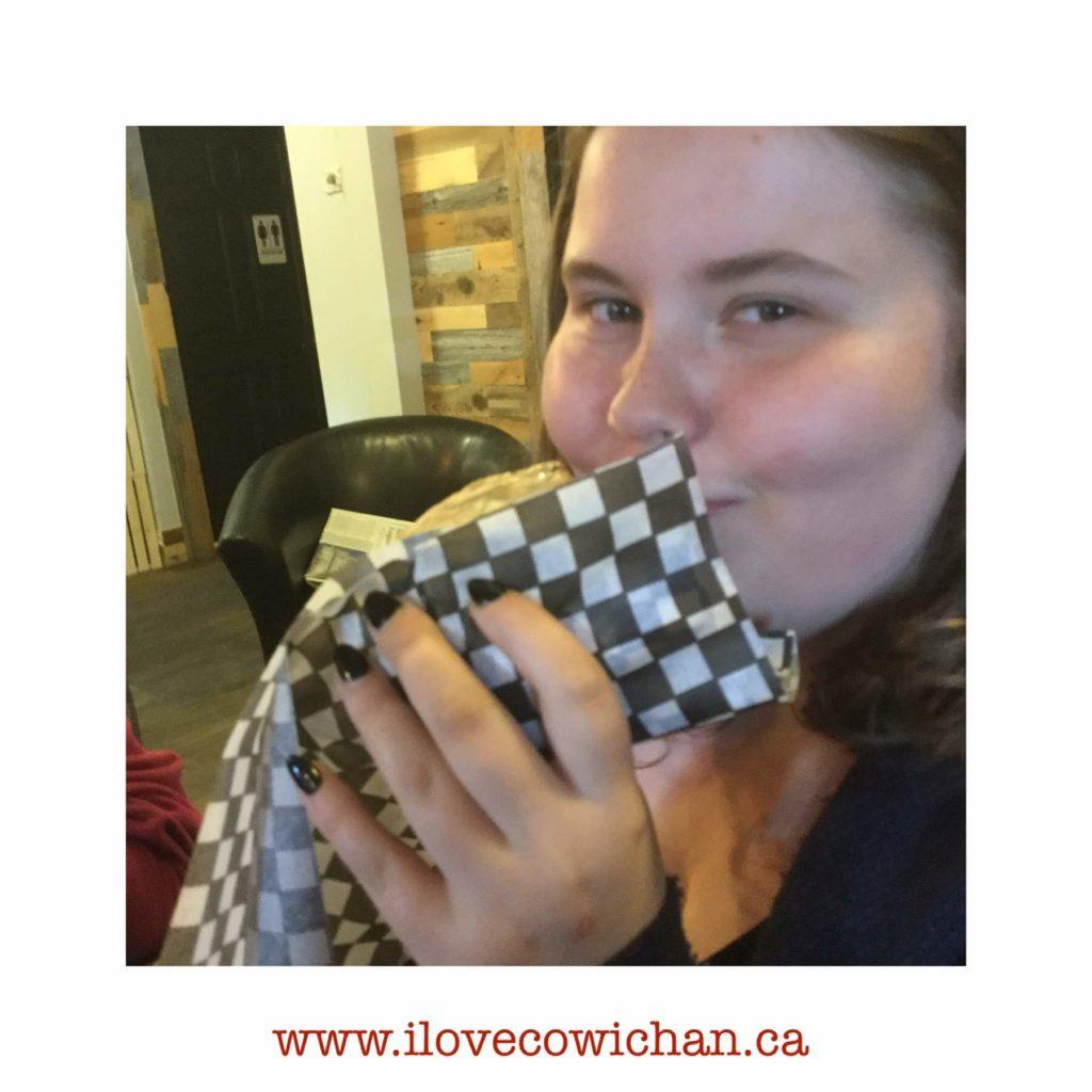 Local Artist VJB sure is enjoying her chocolate chip cookie ice cream sandwich.